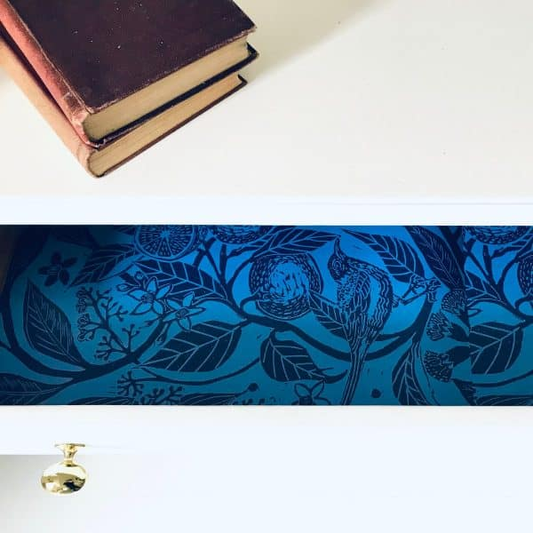 Open drawer with scented paper inside showcasing two tone blue ink block print.