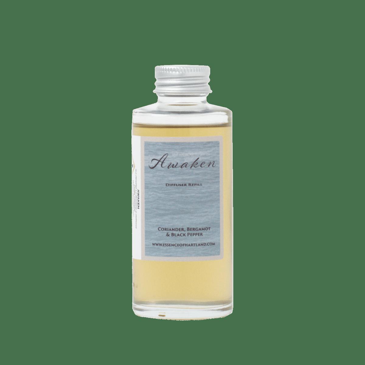 Glass diffuser refill bottle with Awaken written on the label.