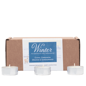 Box with printed label with Winter 12 Essential Oil Tealights written on it. 3 tealights sat in front of the box.