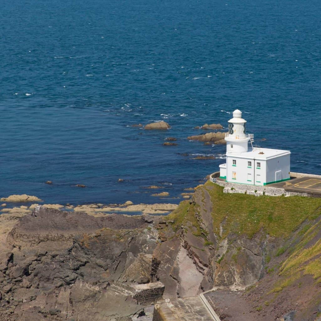 Hartland Lighthouse with a view out to sea.